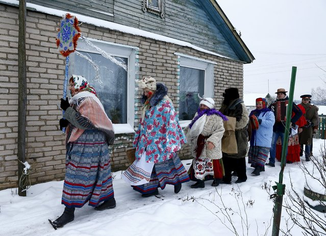 "People celebrate the pagan rite called ""Kolyadki"" in the village of Skirmantava, Belarus, January 7, 2016. Kolyada is a pagan winter holiday, which over the centuries has merged with Orthodox Christmas celebrations in some parts of Belarus. (Photo by Vasily Fedosenko/Reuters)"