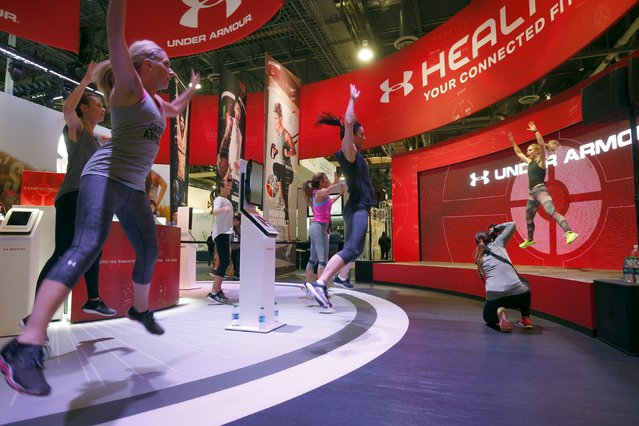 People work out at the Under Armour booth as the company promotes the Health Box, a Connected Fitness system, during the 2016 CES trade show in Las Vegas, Nevada January 8, 2016. (Photo by Steve Marcus/Reuters)