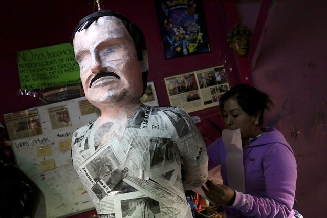 """An artisan works on a pinata depicting the drug lord Joaquin """"El Chapo"""" Guzman at a workshop in Reynosa, in Tamaulipas state, Mexico, January 13, 2016. (Photo by Daniel Becerril/Reuters)"""
