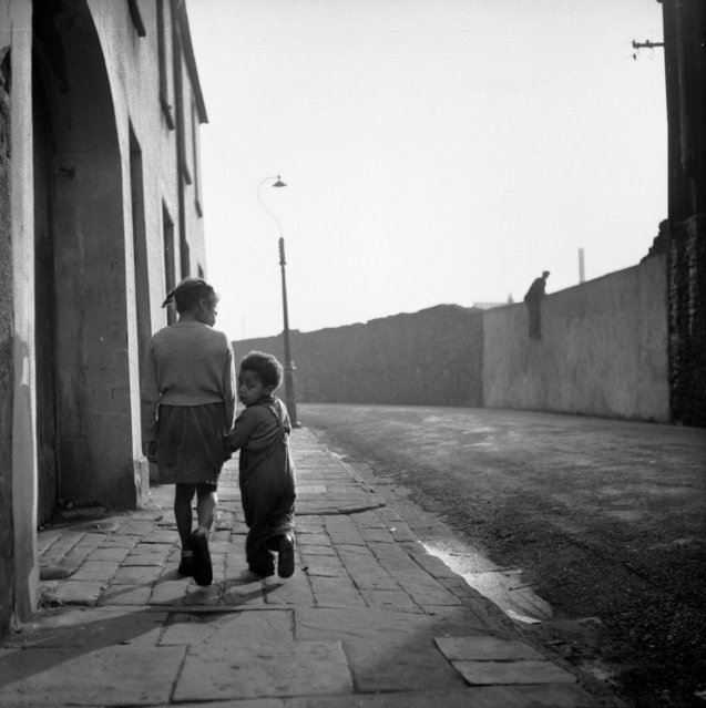 Children walk the streets in Bute Town, one of the poorest areas of Cardiff, 23rd January 1954. The area has a lively ethnic mix of families with Arab, Somali, West African, West Indian, Egyptian, Greek, and many other origins. (Photo by Bert Hardy/Picture Post/Getty Images)