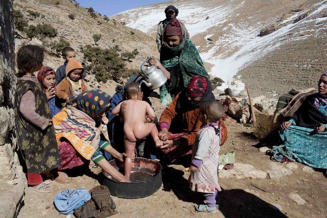 Berber women wash a child in Ait Sghir village in the High Atlas region of Morocco February 14, 2015. (Photo by Youssef Boudlal/Reuters)