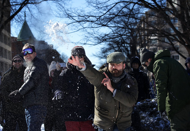 People participate in a snowball fight at Dupont Circle January 24, 2016 in Washington, DC. (Photo by Alex Wong/Getty Images)