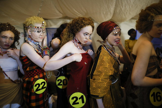 Albino women prepare backstage prior to their fashion show during the Mr. & Miss Albinism East Africa contest in Nairobi, Kenya, 30 November 2018. (Photo by Dai Kurokawa/EPA/EFE)