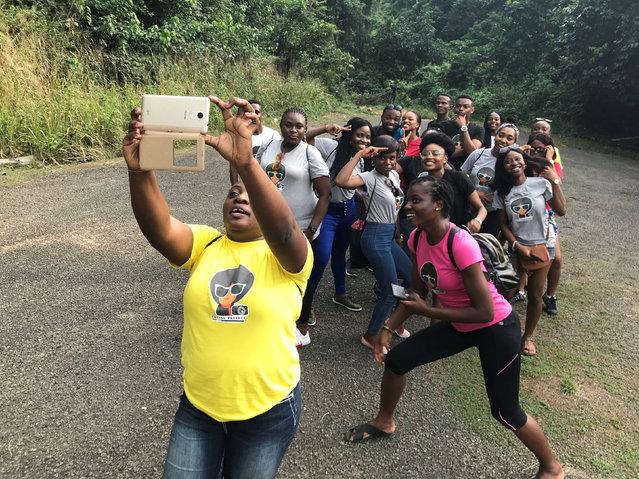 Tourists are seen gathered for a selfie photo at Ikogosi Warm Springs resort in Ekiti, Ekiti State, Nigeria November 10, 2018. (Photo by Seun Sanni/Reuters)