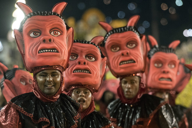 A performer dances during Sao Clemente performance at the Rio Carnival in Sambodromo on February 8, 2016 in Rio de Janeiro, Brazil. (Photo by Raphael Dias/Getty Images)