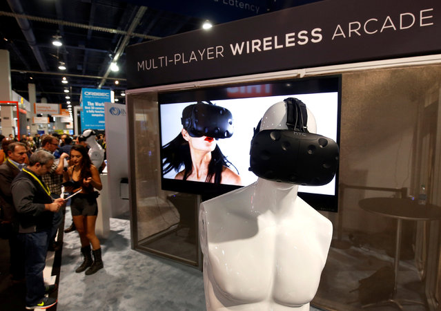Australian-based Immersive Robotics promotes their multi-player wireless VR streaming system during the 2017 CES in Las Vegas, Nevada, U.S., January 6, 2017. The company is trying to create a compression standard for VR content, a representative says. (Photo by Steve Marcus/Reuters)