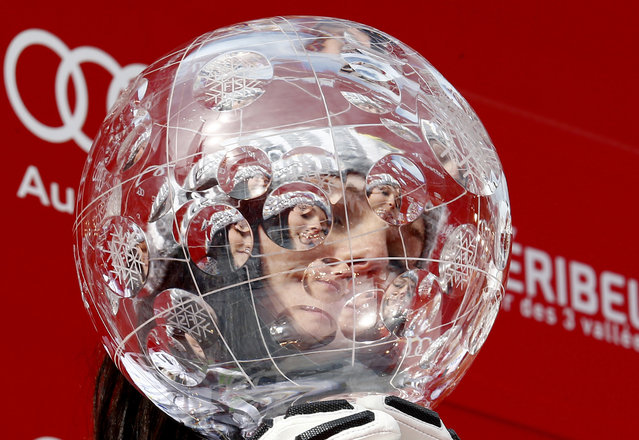 Anna Fenninger is seen trhough her alpine ski, women's World Cup overall trophy, at the World Cup finals in Meribel, France, Sunday, March 22, 2015. (Photo by Giovanni Auletta/AP Photo)