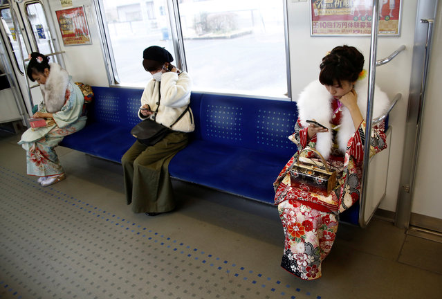 Japanese women wearing kimonos ride the train to attend the Coming of Age Day celebration in Tokyo, Japan January 9, 2017. (Photo by Kim Kyung-Hoon/Reuters)