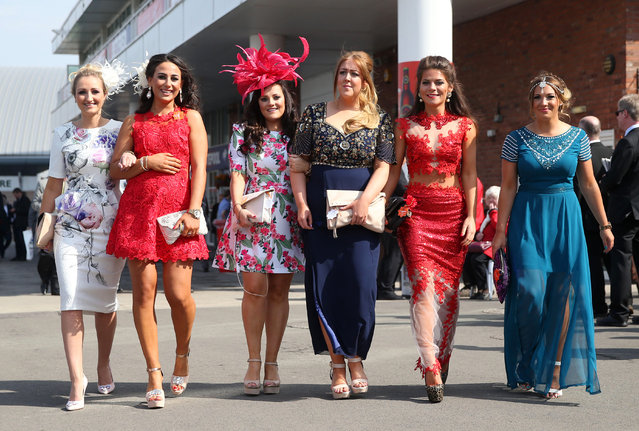 Horse Racing – Crabbie's Grand National Festival – Aintree Racecourse April 10, 2015: Racegoers pose at the Grand National Festival on ladies day. (Photo by Matthew Childs/Reuters)