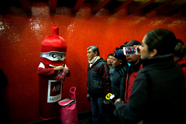 A man wearing a costume, representing a condom, is seen at a metro station giving free condoms on the International Condoms Day, celebrated a day before Valentine Day, in Mexico City, Mexico, February 13, 2019. (Photo by Carlos Jasso/Reuters)