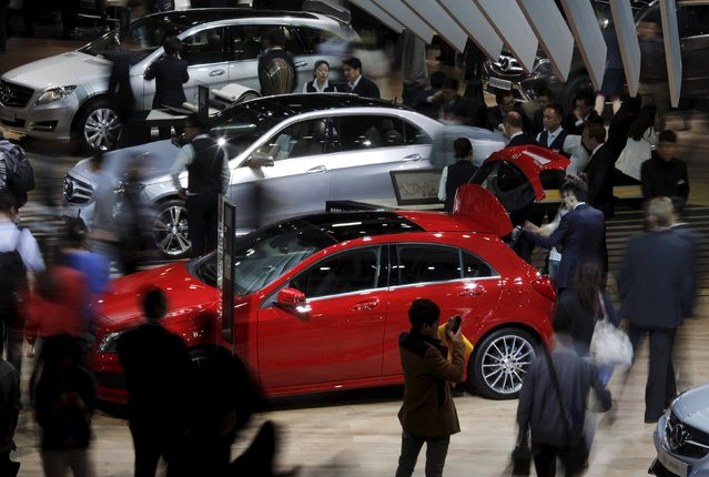Visitors walk around Mercedes Benz cars during the 16th Shanghai International Automobile Industry Exhibition in Shanghai, April 20, 2015. (Photo by Carlos Barria/Reuters)