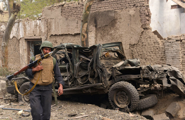 An Afghan security forces stands near to site of a suicide attack on the Indian consulate in the city of Jalalabad east of Kabul, Afghanistan, Wednesday, March 2, 2016. An Afghan official says two civilians have been killed and 19 wounded in an attempted car bomb attack on the Indian consulate in the eastern city of Jalalabad. An official at the Indian embassy in Kabul, Anil Kumar, says all consulate staff are safe. (Photo by Mohammad Anwar Danishyar/AP Photo)