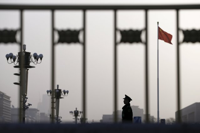A paramilitary policeman stands guard outside the Great Hall of the People ahead of the opening session of the National People's Congress (NPC) in Beijing, China, March 5, 2016. (Photo by Aly Song/Reuters)