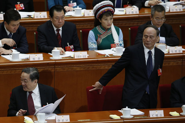 China's Politburo Standing Committee member Wang Qishan (R) take a seat next to Yu Zhengsheng (L), Chairman of the National Committee of the Chinese People's Political Consultative Conference (CPPCC) during the second plenary session of the NPC at the Great Hall of the People in Beijing, China, March 9, 2016. (Photo by Kim Kyung-hoon/Reuters)
