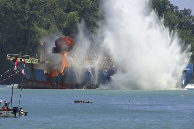 In this image made from video, illegal fishing vessel Viking which was seized by Indonesia's Navy is sunk in the waters off Pangandaran, West Java, Indonesia, Monday, March 14, 2016. Indonesian authorities used explosives to sink the last major sought-after illegal fishing vessel on Monday after it had evaded international authorities for years, reiterating a strong message to would-be poachers that enter the country's waters. (Photo by AP Photo/APTN)