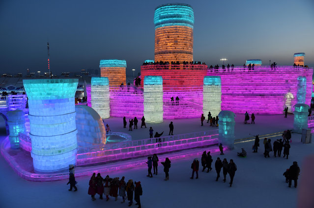 Tourists view ice sculptures at Harbin Ice-Snow World in Harbin, capital of northeast China's Heilongjiang Province, February 7, 2017. (Photo by Xinhua/Barcroft Images)