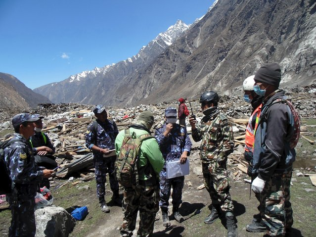 Soldiers take part in a operation to recover bodies after a massive avalanche triggered by last week's earthquake overwhelmed Langtang village, Nepal, in this May 2, 2015 police handout photo. About 100 bodies were recovered on Saturday and Sunday at Langtang village, 60 km (37 miles) north of Kathmandu, which is on a trekking route popular with Westerners. (Photo by Reuters)