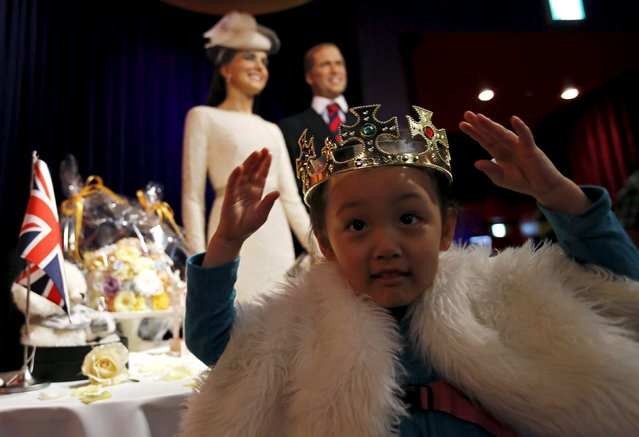 Visitor Kokoro Inao, 4, poses in front of wax figures of Britain's Prince William and Kate Middleton, Duchess of Cambridge, at the Madame Tussauds Tokyo wax museum in Tokyo May 3, 2015. Britain's Duchess of Cambridge, the wife of Prince William, gave birth to a girl on Saturday, the couple's second child and a great grand-daughter to Queen Elizabeth. (Photo by Toru Hanai/Reuters)