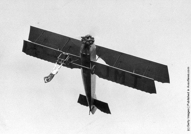 French barnstormer Vassard performing one of his death-defying stunts