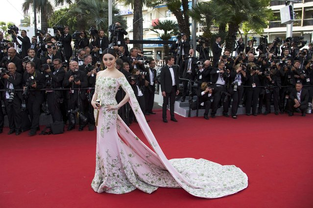 """Actress Fan Bingbing poses on the red carpet as she arrives for the opening ceremony and the screening of the film """"La tete haute"""" out of competition during the 68th Cannes Film Festival in Cannes, southern France, May 13, 2015. (Photo by Yves Herman/Reuters)"""