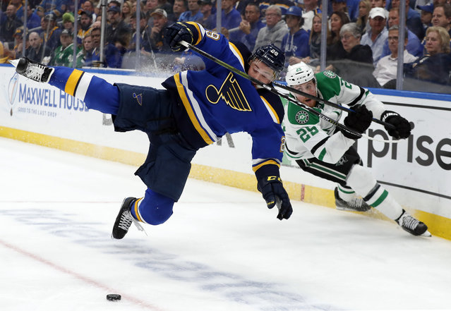 St. Louis Blues defenseman Vince Dunn (29) and Dallas Stars right wing Brett Ritchie (25) compete for control of a loose puck during the first period in Game 7 of an NHL second-round hockey playoff series, Tuesday, May 7, 2019, in St. Louis. (Photo by Jeff Roberson/AP Photo)