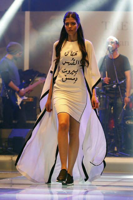 "A model presents a creation during ""The Designer: The 2016 Jordan Fashion Award"" competition in Amman, Jordan, March 29, 2016. Picture taken March 29, 2016. Writing on the dress: ""Amman, Jerusalem, Beirut and Damascus"". (Photo by Muhammad Hamed/Reuters)"