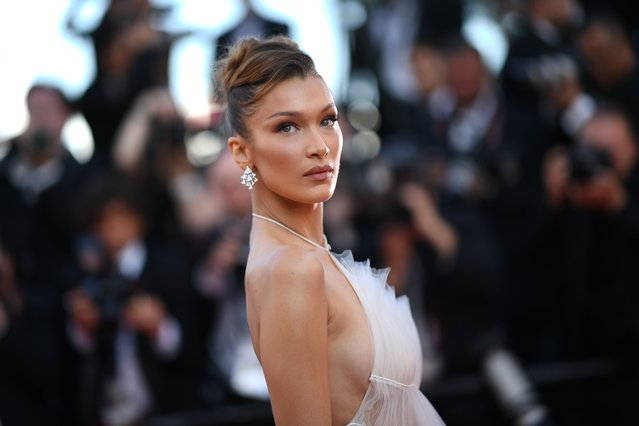 """US model Bella Hadid poses as she arrives for the screening of the film """"Rocketman"""" at the 72nd edition of the Cannes Film Festival in Cannes, southern France, on May 16, 2019. (Photo by Loic Venance/AFP Photo)"""