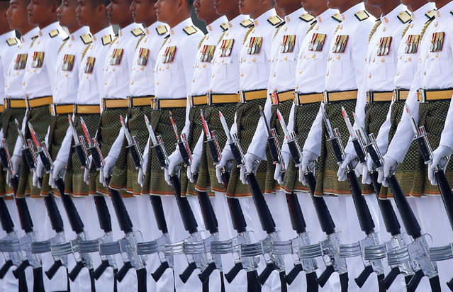 An honour guard waits for the arrival of Saudi Arabia's King Salman at the Parliament House in Kuala Lumpur, Malaysia February 26, 2017. (Photo by Edgar Su/Reuters)