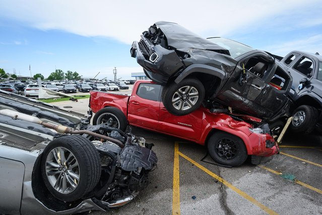 Trucks are piled on top of each other at Riley Auto Group on May 23, 2019 in Jefferson City, Missouri, after a tornado struck there. A series of powerful tornadoes killed at least three people in southwestern Missouri causing extensive damage in Jefferson City, the state capital. (Photo by Reed Hoffmann/Getty Images)