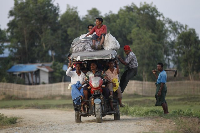 Rohingya Muslims ride a vehicle as they travel outside Sitttwe, Myanmar May 21, 2015. Picture taken May 21, 2015. (Photo by Soe Zeya Tun/Reuters)
