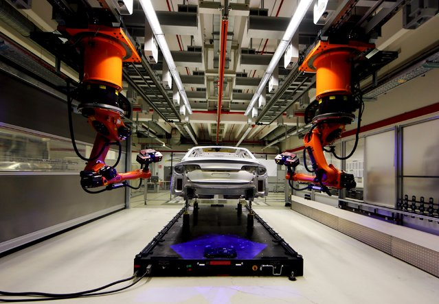 A robot is seen assembling Audi A8 models at their plant in Neckarsulm near Heilbronn May 21, 2015. Audi will hold their annual shareholders meeting on May 22, 2015. (Photo by Michael Dalder/Reuters)