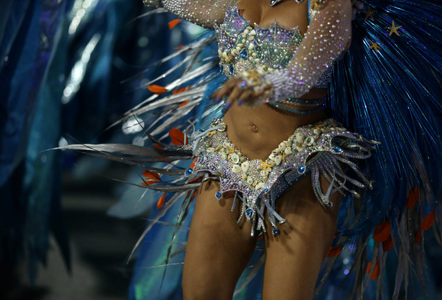 A reveller from Sao Clemente samba school performs during the second night of the carnival parade at the Sambadrome in Rio de Janeiro, Brazil February 28, 2017. (Photo by Pilar Olivares/Reuters)