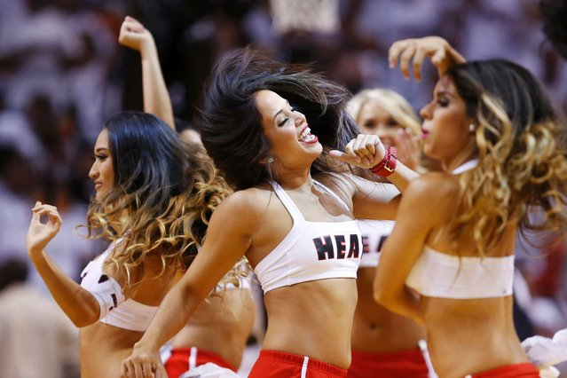 Heat cheerleaders perform during a break in play as the Heat play the Spurs during Game 1 of their NBA Finals basketball playoff in Miami. (Photo by Mike Segar/Reuters)