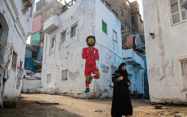 A woman walks in front of a mural depicting Liverpool's Egyptian striker Mohamed Salah in Cairo, Egypt, 15 June 2019. The 2019 Africa Cup of Nations (AFCON) will take place from 21 June until 19 July 2019 in Egypt. (Photo by Mohamed Hossam/EPA/EFE)
