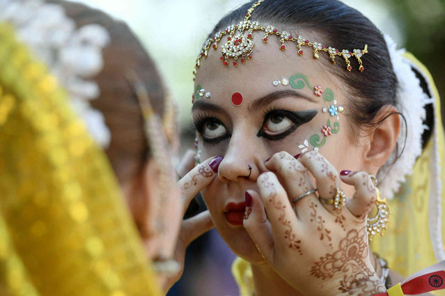 A Lord Krishna devotee is made up before the start of the Festival of Chariots, Ratha-yatra, held by the community of the Krishna Consciousness to honour Jagannatha, the Lord of the Universe, in Budapest, Hungary, Saturday, June 29, 2019. (Photo by Szilard Koszticsak/MTI via AP Photo)