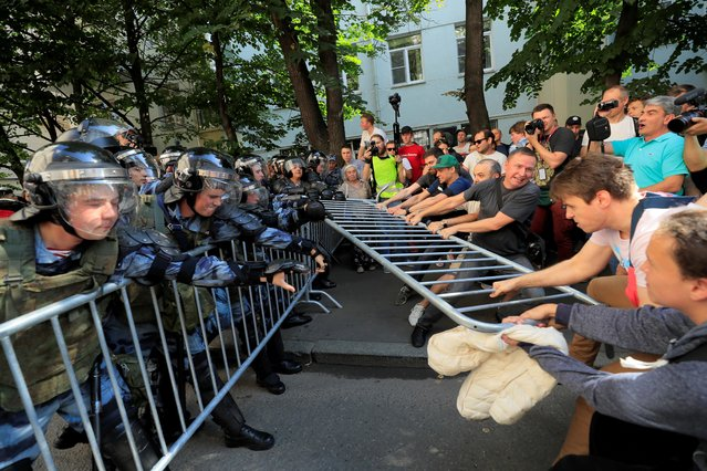 Protesters attempt to remove fences during a rally calling for opposition candidates to be registered for elections to Moscow City Duma, the capital's regional parliament, in Moscow, July 27, 2019. (Photo by Tatyana Makeyeva/Reuters)