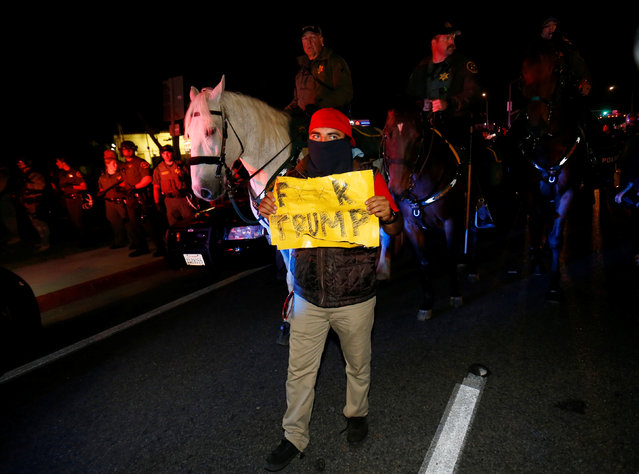 Police on horse back force a demonstrator away from a rally point outside Republican U.S. presidential candidate Donald Trump's campaign rally in Costa Mesa, California April 28, 2016. (Photo by Mike Blake/Reuters)