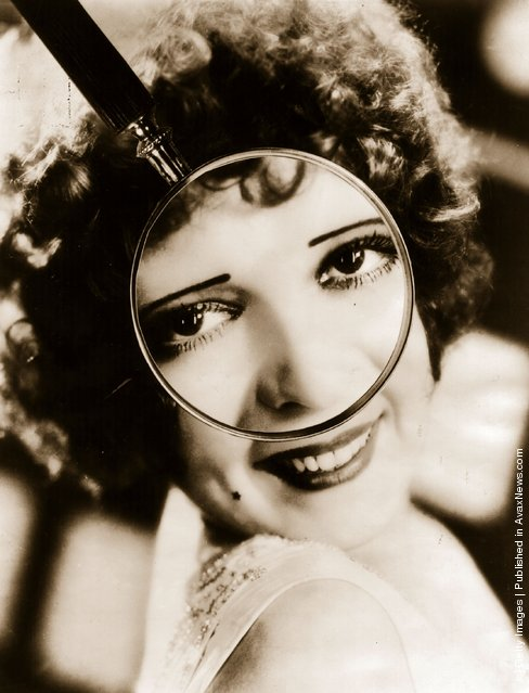 1927: Portrait of Clara Bow through a magnifying glass, captioned Is Clara Bow's charm in the sparkle of her eyes?