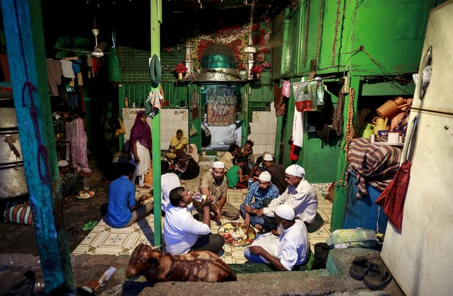 Muslims eat their Iftar (breaking of fast) meal during the holy month of Ramadan inside a shrine in Mumbai, India, July 6, 2015. (Photo by Danish Siddiqui/Reuters)