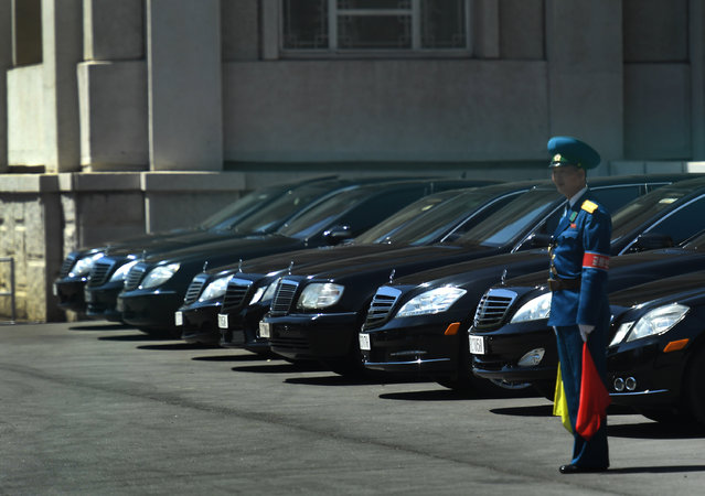 View of a long row of Mercedes Benz vehicles in front of the People's Palace of Culture in Pyongyang, North Korea on May 8, 2016. It's believed that only the top government officials travel in Mercedes. (Photo by Linda Davidson/The Washington Post)