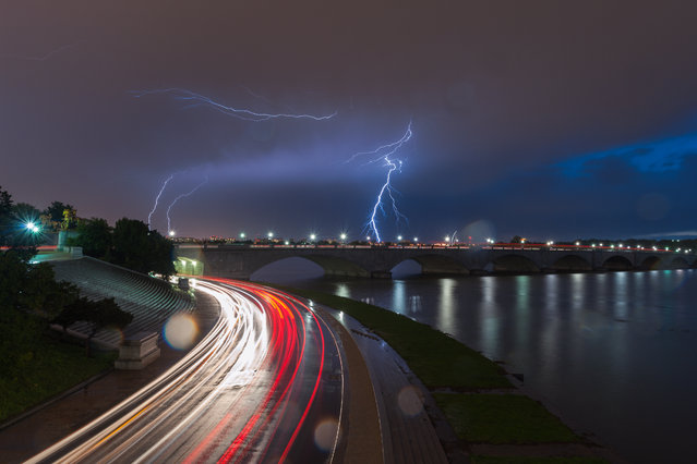 Lightning flashes over Memorial Bridge on Monday evening, April 20, 2015 in Washington, D.C. (Photo by Craig Hudson/The Washington Post)