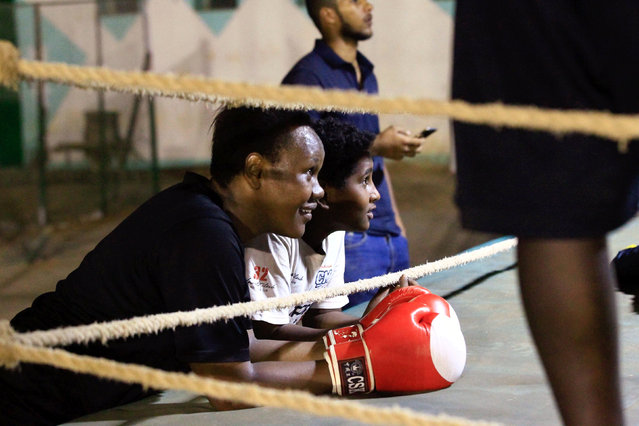 Arafat Abkar (L), 22, looks on during boxing practice at Nile Club in Khartoum May 9, 2016. (Photo by Mohamed Nureldin Abdallah/Reuters)