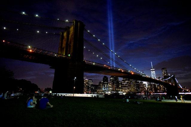 The Tribute in Light memorial is seen in the Manhattan skyline from Brooklyn Bridge Park in Brooklyn, New York, September 10, 2016. (Photo by Mark Kauzlarich/Reuters)