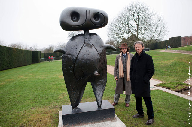 Joan Miro's, grandsons, Emilio Fernandez Miro and Joan Punyet Miro pose beside Personnage (1970) in the Yorkshire Sculpture park
