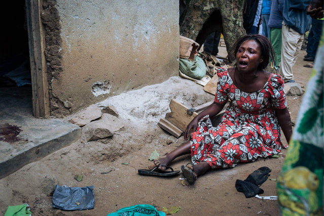 A woman mourns the death of her relatives killed in an attack in Masiani district in Beni last night by armed men gather at the scene on December 23, 2018. At least five people, including four civilians, were killed in an attack by Ugandan rebels over the border with DR Congo, an AFP reporter said on December 23, 2018, quoting witnesses. The attack by Uganda-based Allied Democratic Forces (ADF) targeted the locality of Masiani in Beni region and left at least one soldier dead as well as the civilians. (Photo by Alexis Huguet/AFP Photo)