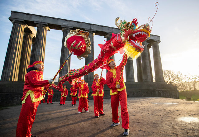 Dancers from the Edinburgh Chinese Education Centre perform a Chinese Dragon dance on January 8, 2020, to launch the 2020 Chinese New Year celebrations and the Year of the Rat on Calton Hill, Edinburgh, Scotland. (Photo by Jane Barlow/PA Images via Getty Images)