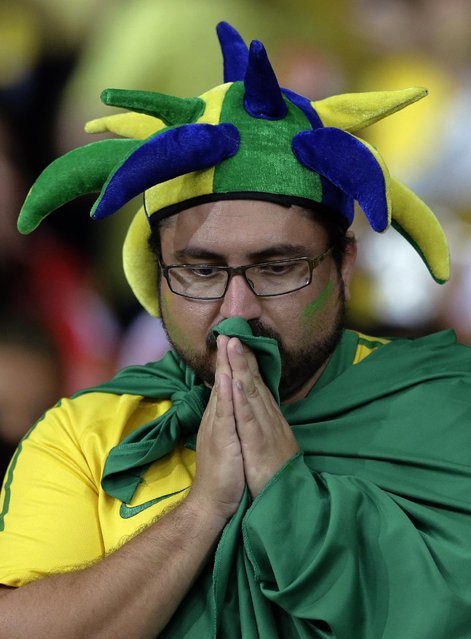 A Brazil supporter reacts during the World Cup semifinal soccer match between Brazil and Germany at the Mineirao Stadium in Belo Horizonte, Brazil, Tuesday, July 8, 2014. (Photo by Matthias Schrader/AP Photo)