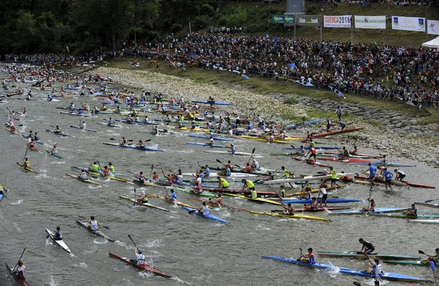 Canoeists start the annual International Descent of the Sella river on canoes, starting from Arriondas and finishing in Ribadesella, in the northern Spanish region of Asturias August 8, 2015. (Photo by Eloy Alonso/Reuters)