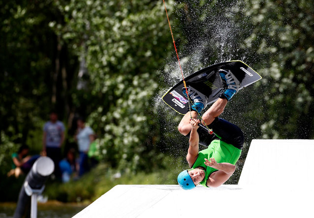 A man takes part in Belarus Wakeboard Cup in Minsk, Belarus June 18, 2016. (Photo by Vasily Fedosenko/Reuters)