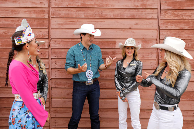 Canadian Prime Minister Justin Trudeau talks with the Calgary Stampede Queen, Princesses and Indian Princess during the Calgary Stampede in Calgary, Alberta, July 15, 2017. (Photo by Todd Korol/Reuters)